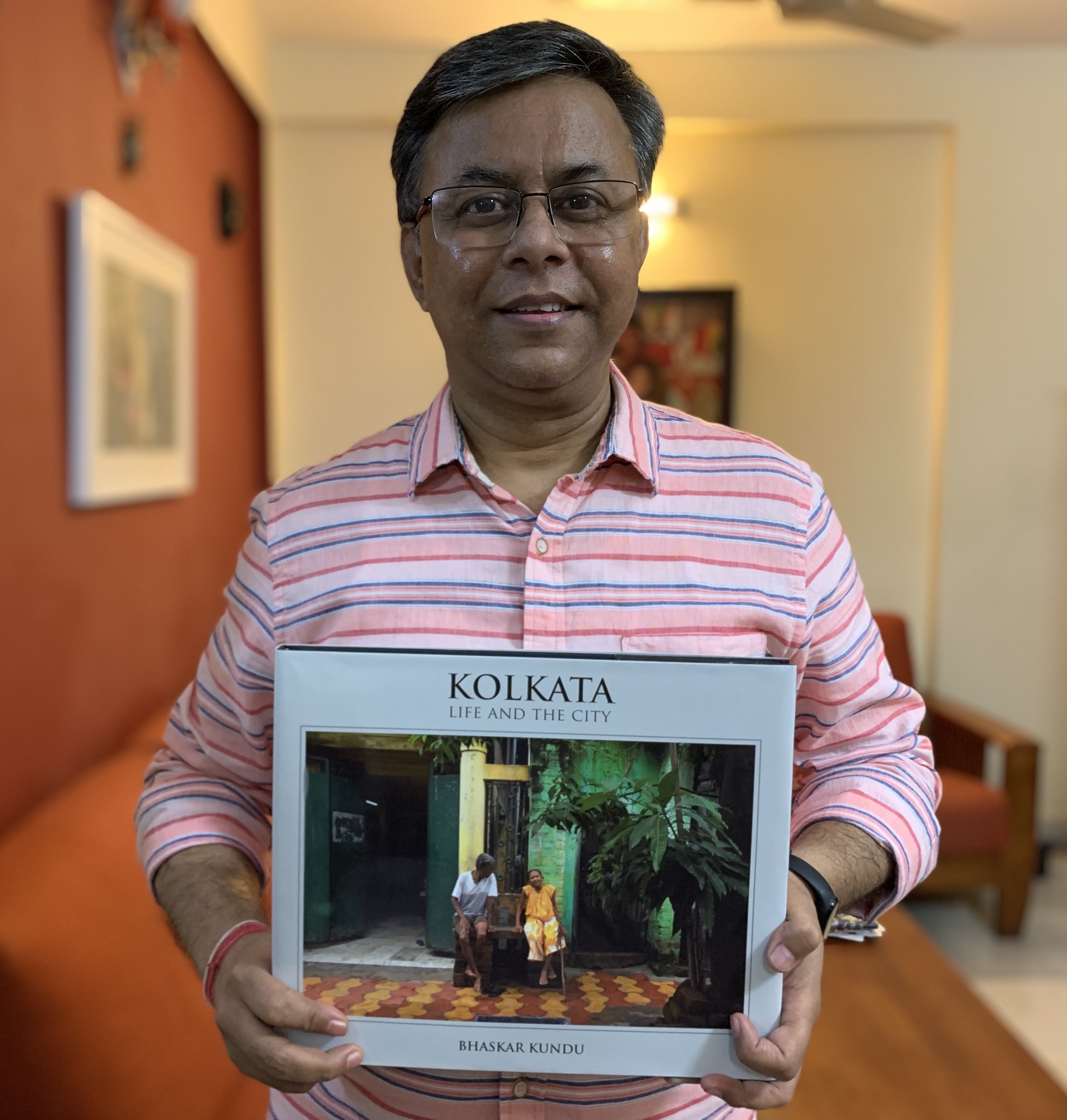 2. Bhaskar Kundu, a celebrated street photographer in his own right proudly displaying the result of years of passion, dedication and hardowrk.